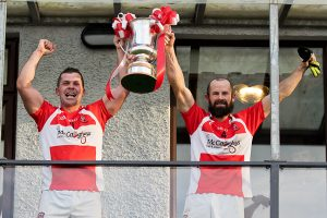 padraig-donaghy-barney-kelly-raise-the-ifc-trophy-high-as-donaghmoyne-are-crowned-2016-champions